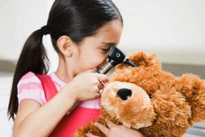 paediatric ENT, child looking in teddy bear's ears